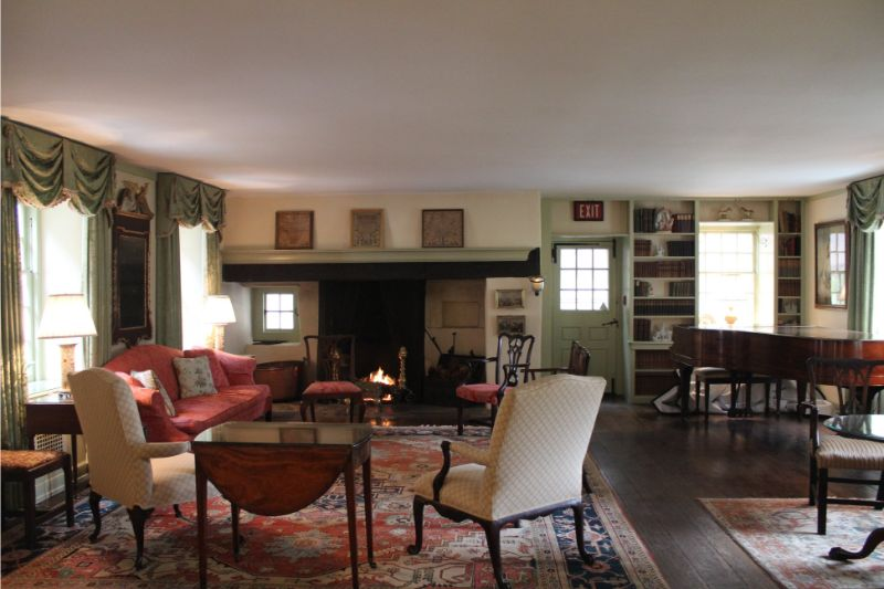 Appleford residence common room with old fashioned chairs and fire place