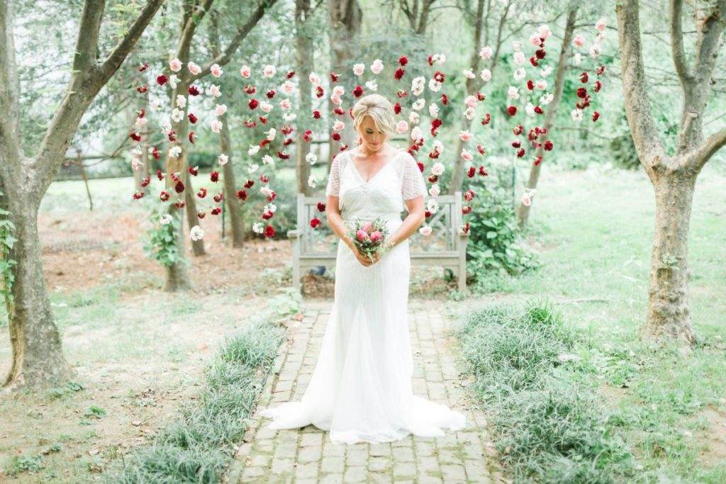bride standing in front of beautiful floating flower display