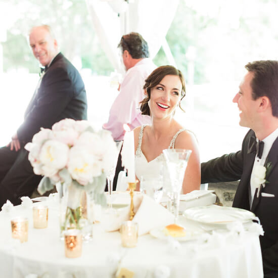 bride and groom sitting at their table